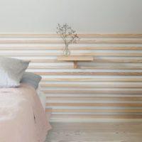 Come decorare la parete dietro il letto in stile minimal